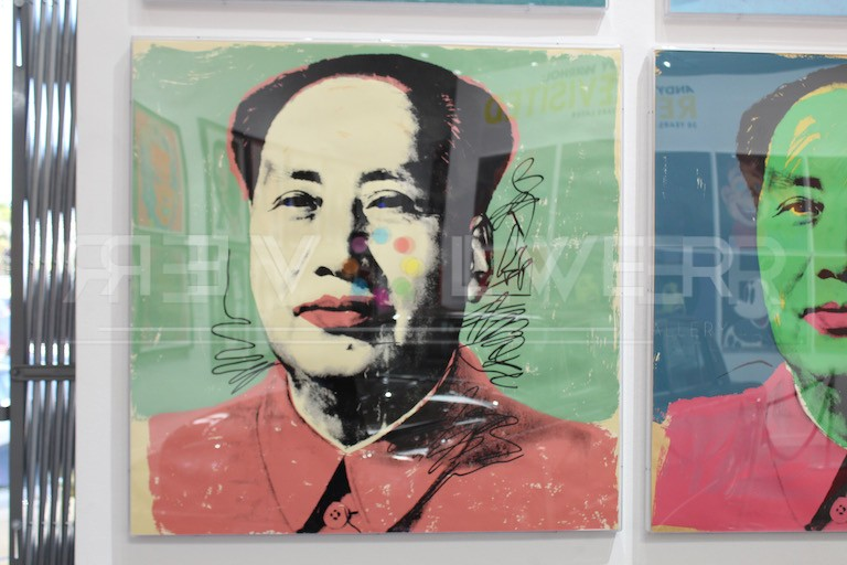 Andy Warhol Mao 96 screenprint framed and hanging on the wall next to other Mao prints.