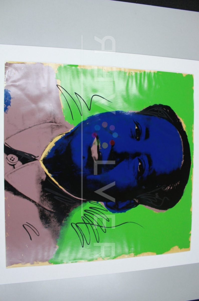 Andy Warhol Mao 90 screenprint out of frame laying on a table.