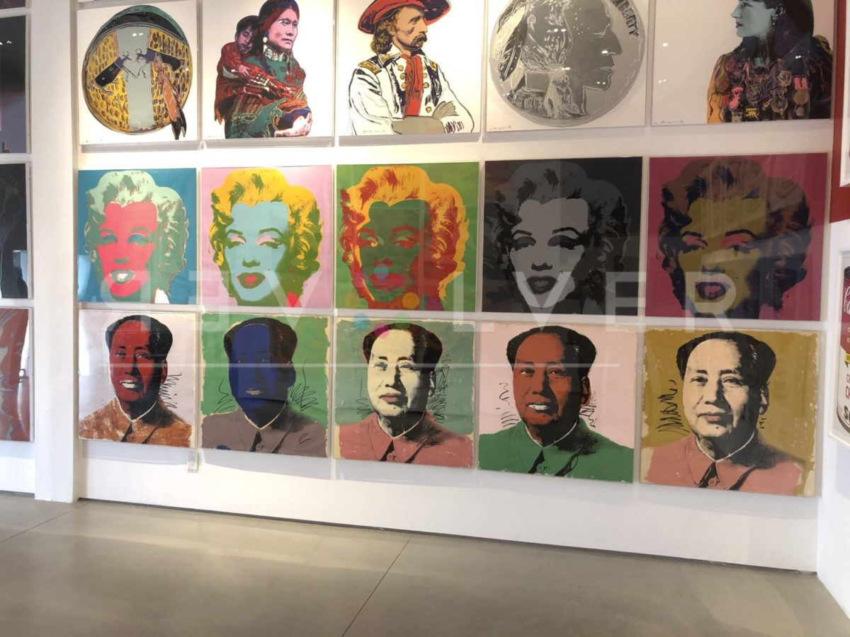 Andy Warhol Marilyn Monroe, Mao, and Cowboys & Indian, on gallery wall.