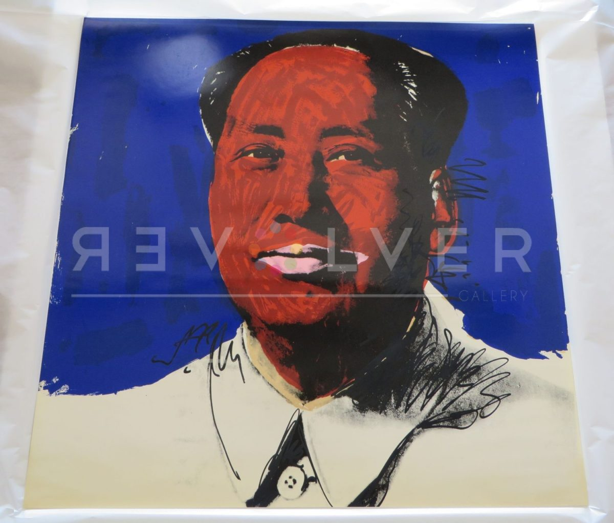 Andy Warhol Mao 98 screenprint out of frame laying on a table.