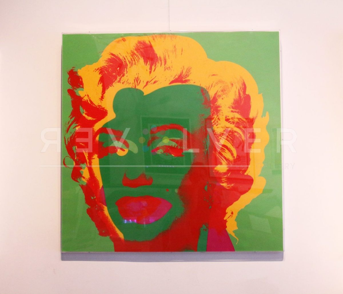 Andy Warhol Marilyn Monroe 25 framed and hanging on the gallery wall.