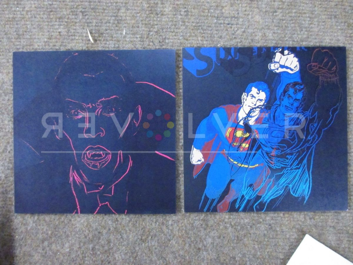 Dracula and Superman by Andy Warhol out of frame and laying on the ground.