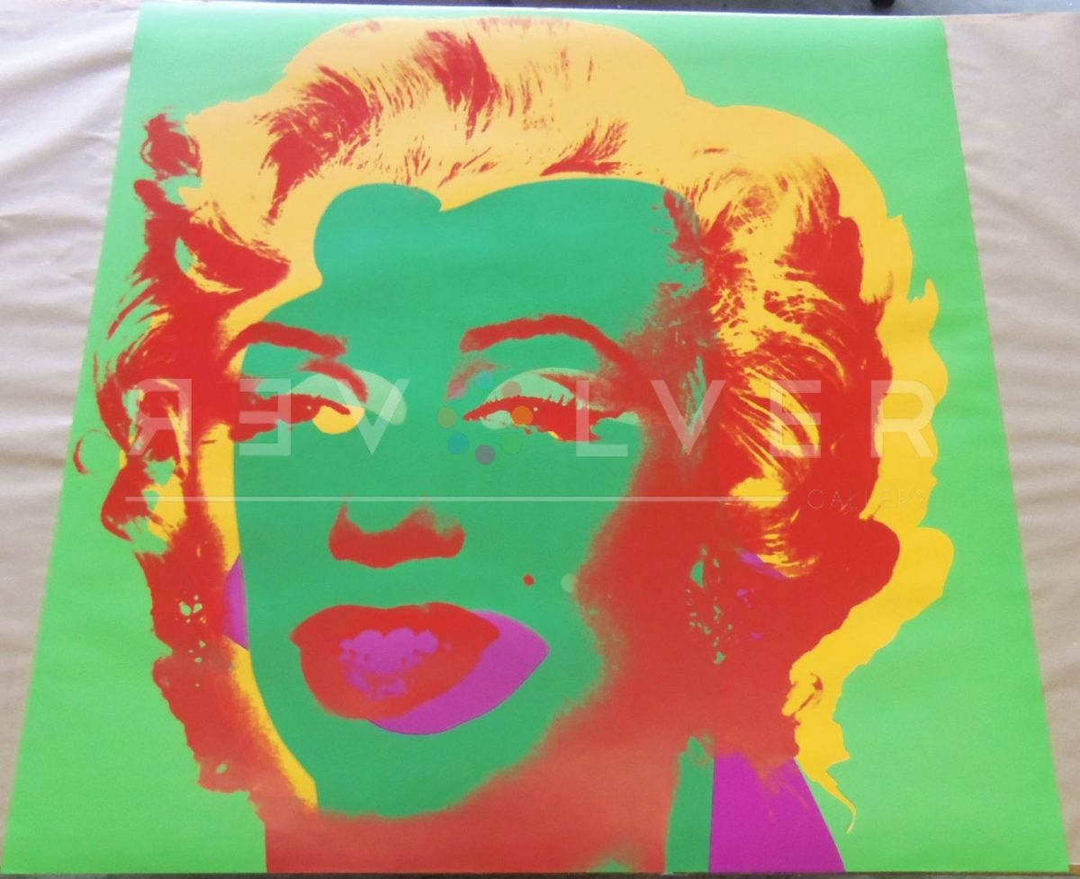 Andy Warhol Marilyn Monroe 25 screenprint out of frame laying on a table.