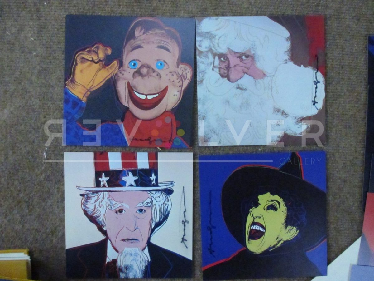 Four screenprints from Andy Warhol's Myths, including Santa Claus 266, out of frame and laying on the ground.