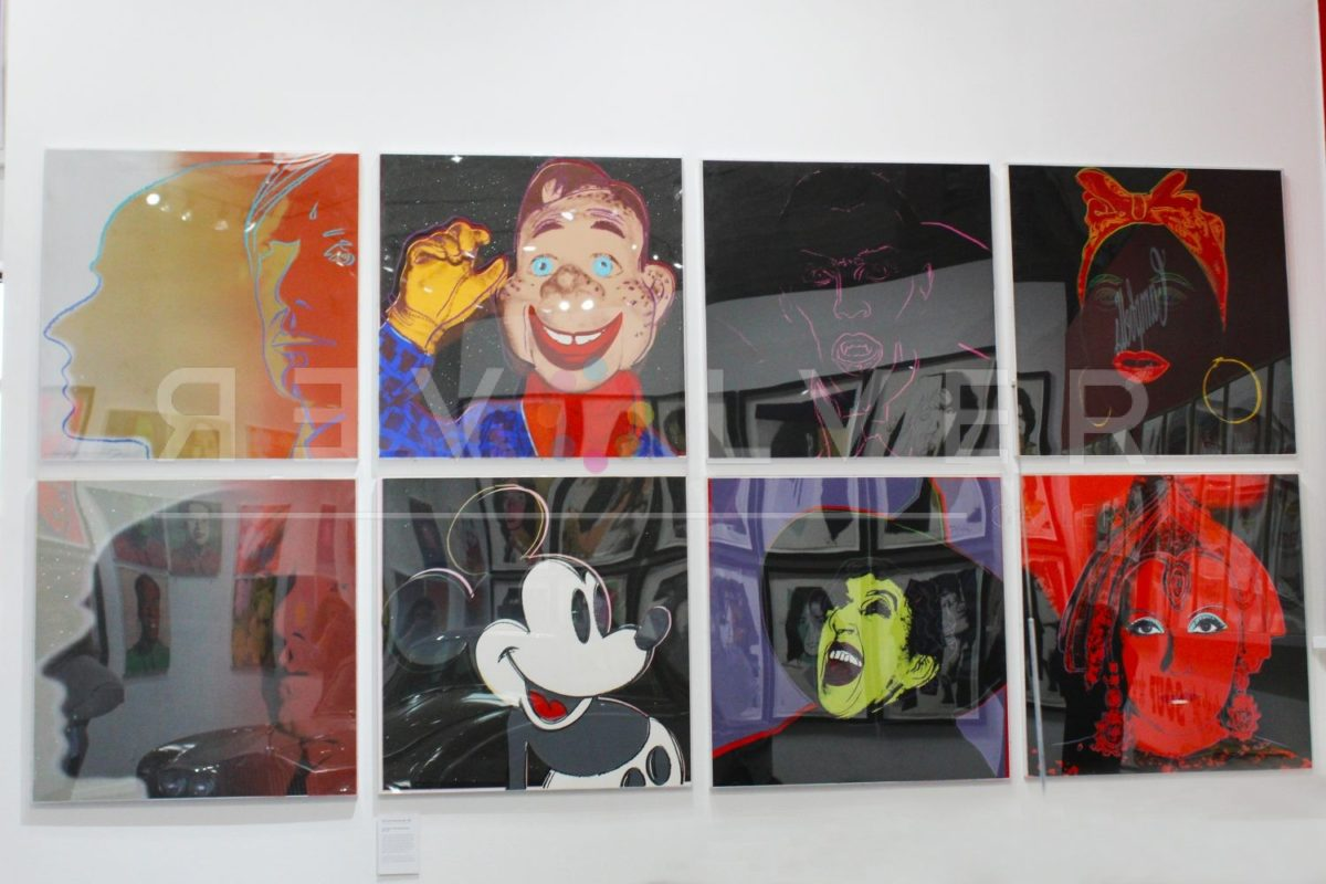 Screenprints from Warhol's Myths series hanging on the gallery wall.