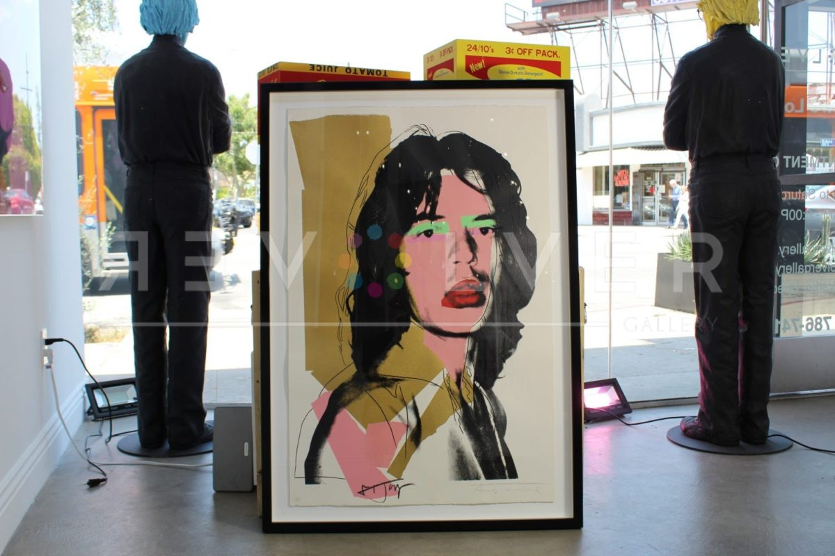 Andy Warhol Mick Jagger 143 screenprint framed and sitting upright on the ground.