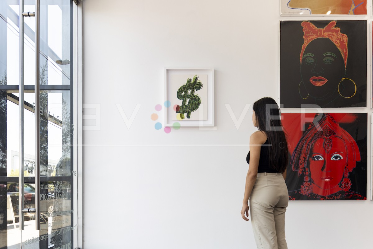 A gallery guest admiring the Dollar sign 278 screenprint hanging on the wall to show the relative size of the artwork.