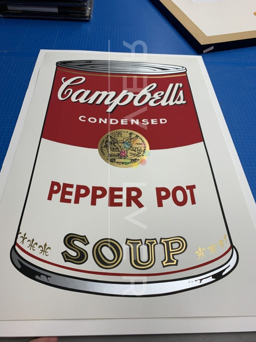 Andy Warhol Campbell's Soup I: Pepper Pot 51 screenprint out of frame laying on a table.