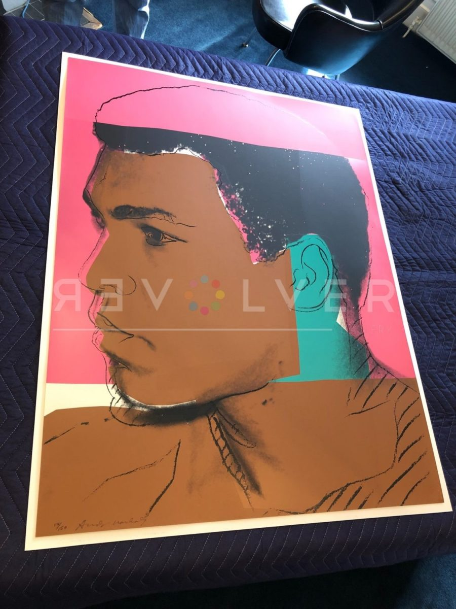 Andy Warhol Muhammad Ali 179 screenprint out of frame and laying on a clothed table.