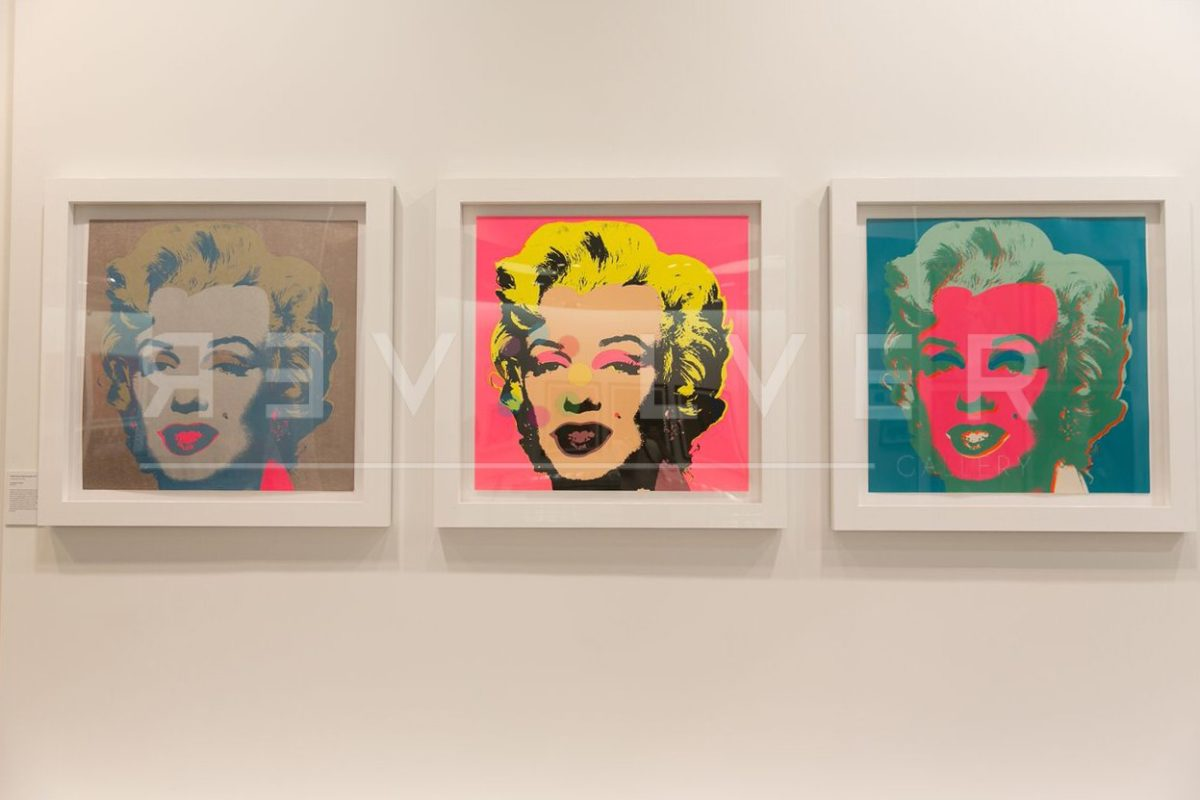Marilyn Monroe 26 by Andy Warhol framed and hanging on the wall next to other Marilyns from the series.