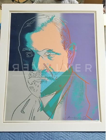 Andy Warhol Sigmund Freud 235 screenprint in frame being held up by a person.