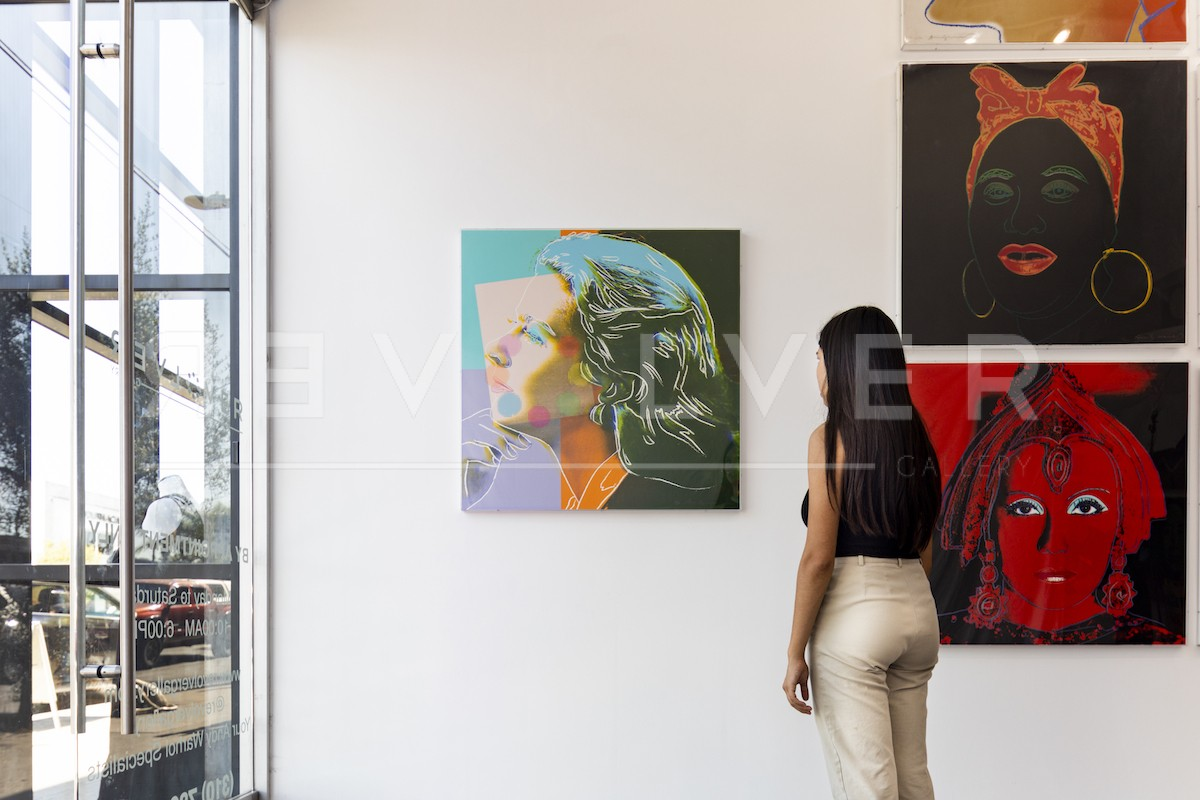 Gallery guest admiring the Ingrid Bergman, Herself 313 screenprint, showing the relative size of the artwork.