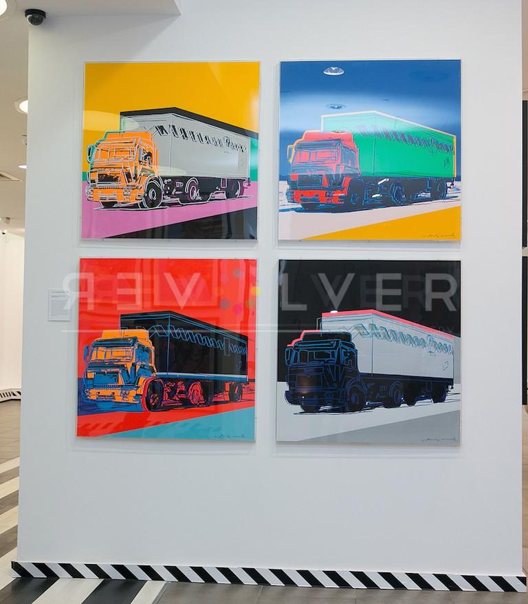 Trucks Portfolio by Andy Warhol hanging on gallery wall.
