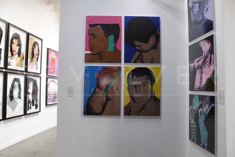 Andy Warhol Muahammad Ali screenprints framed and hanging on the wall.