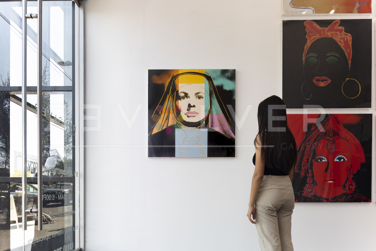 Gallery guest admiring the Ingrid Bergman, The Nun 314 screenprint, showing the relative size of the artwork.