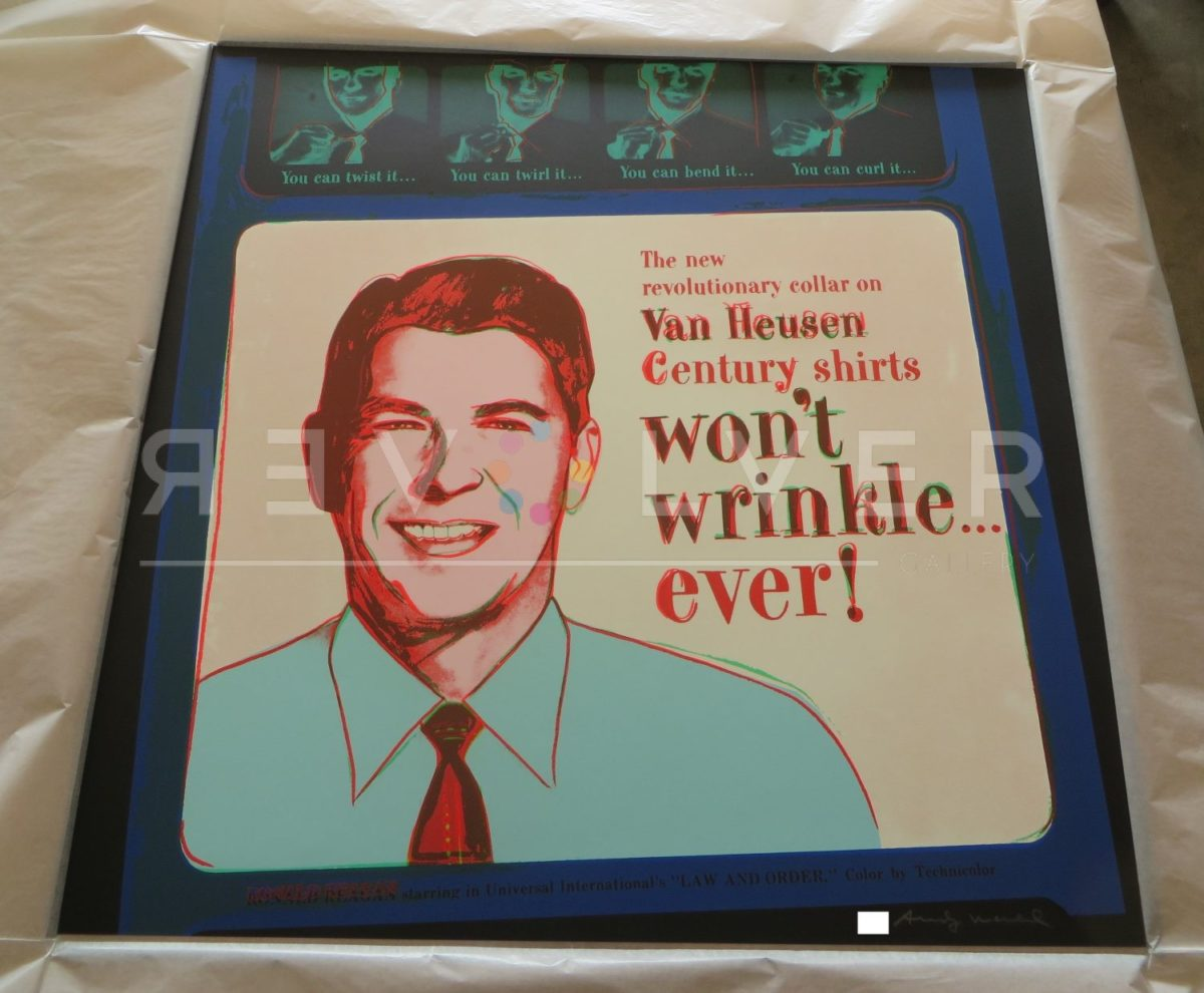 Andy Warhol Van Heusen 356 (Ronald Reagan) screenprint out of frame and laying on a table.