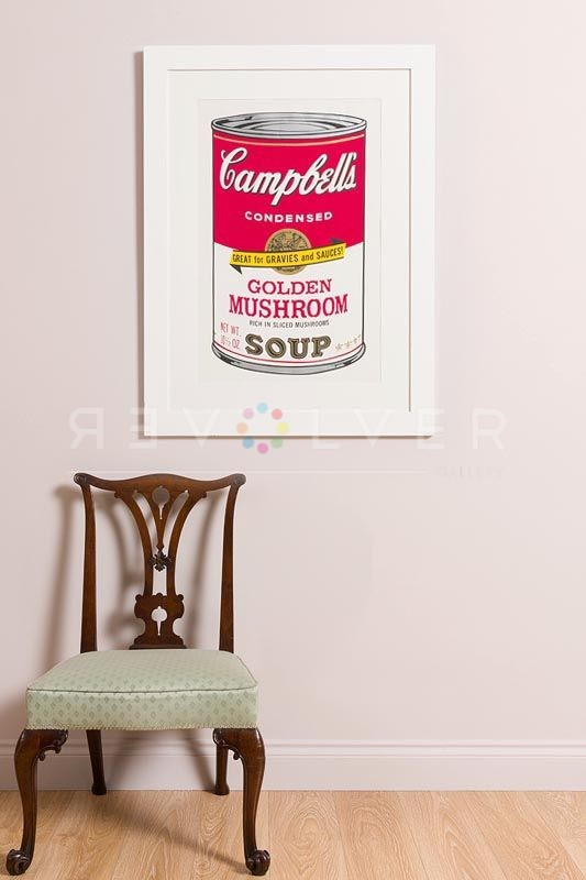 Andy Warhol Campbell's Soup II: Golden Mushroom 62 screenprint framed and hanging on the wall next to a chair.