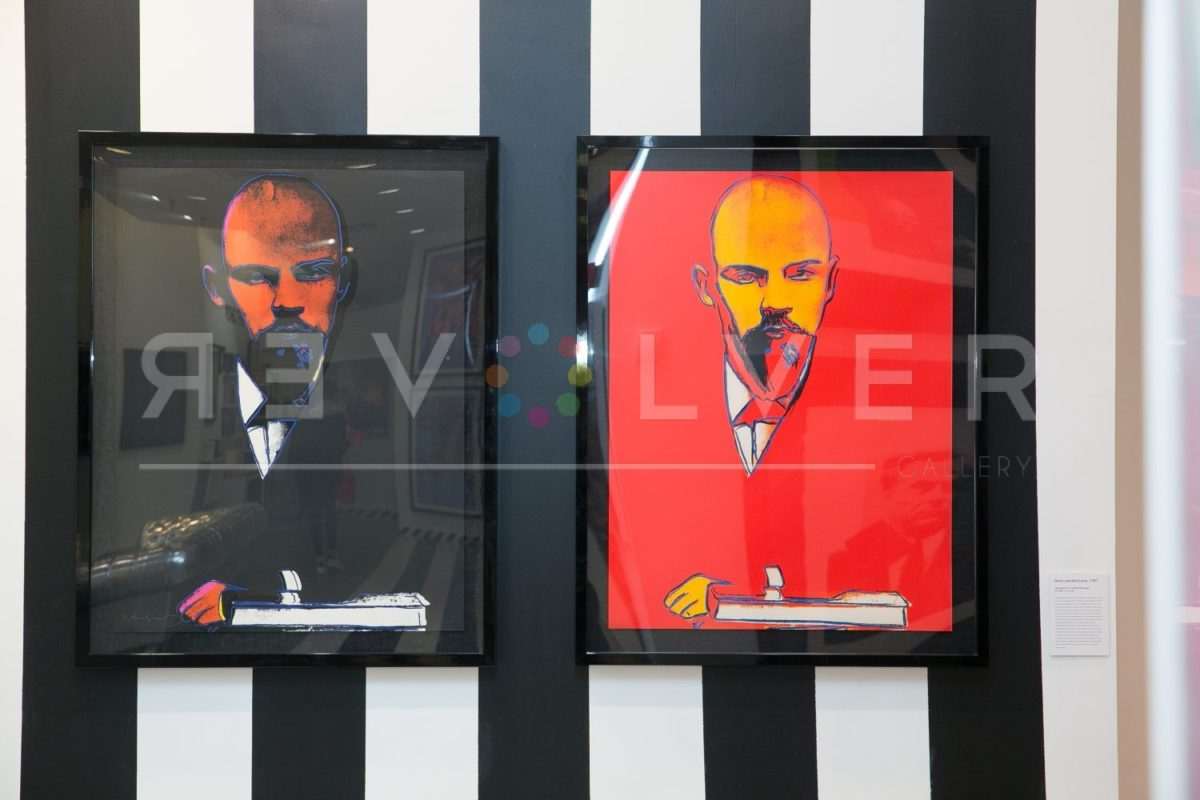 Red Lenin 403 and Lenin 402 by Andy Warhol hanging on a black and white striped wall.