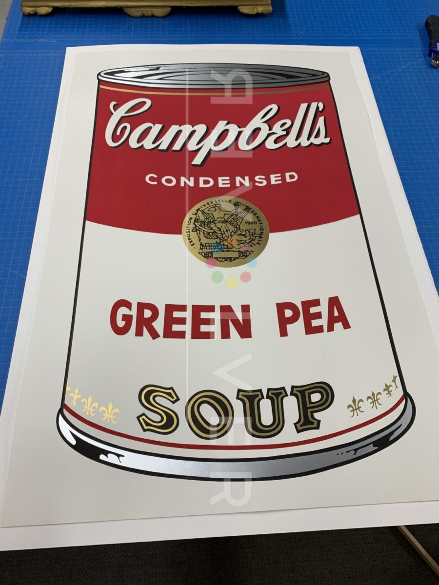 Andy Warhol Campbell's Soup I: Green Pea 50 screenprint out of frame laying on a table.