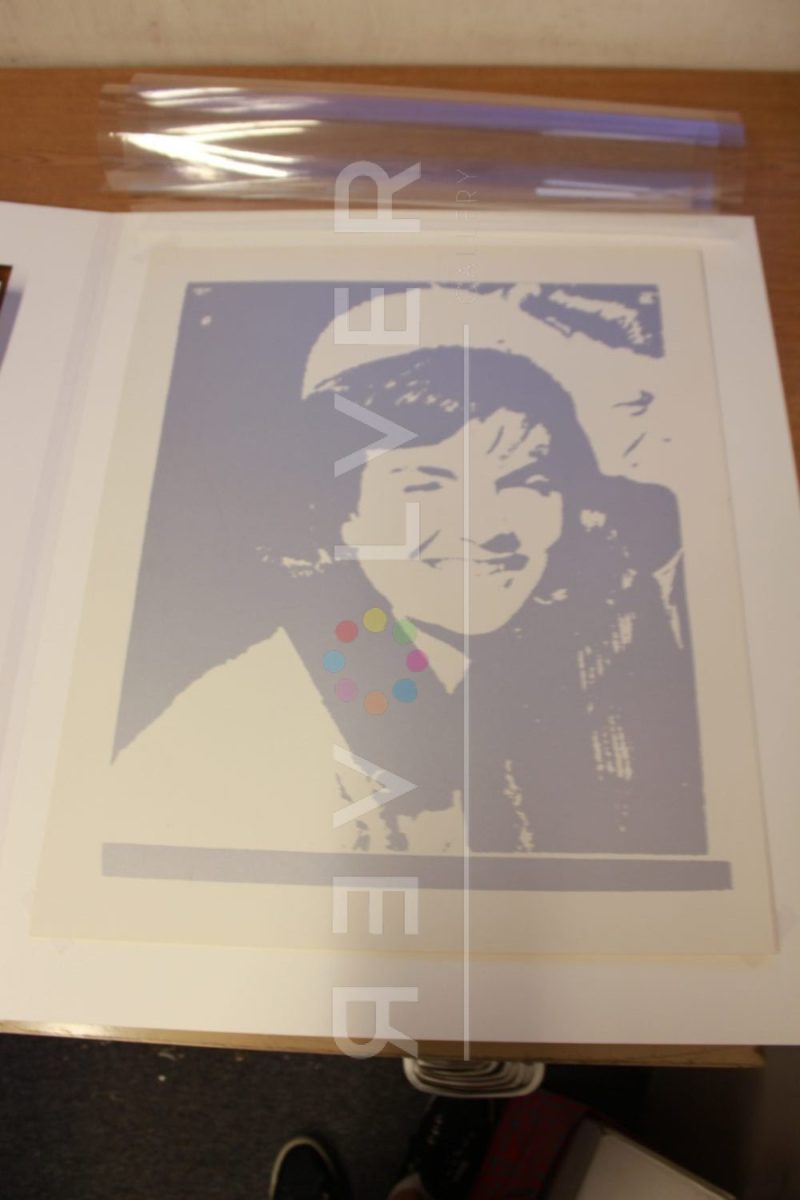 Andy Warhol Jacqueline Kennedy I (Jackie I) 13 screenprint framed laying on table.