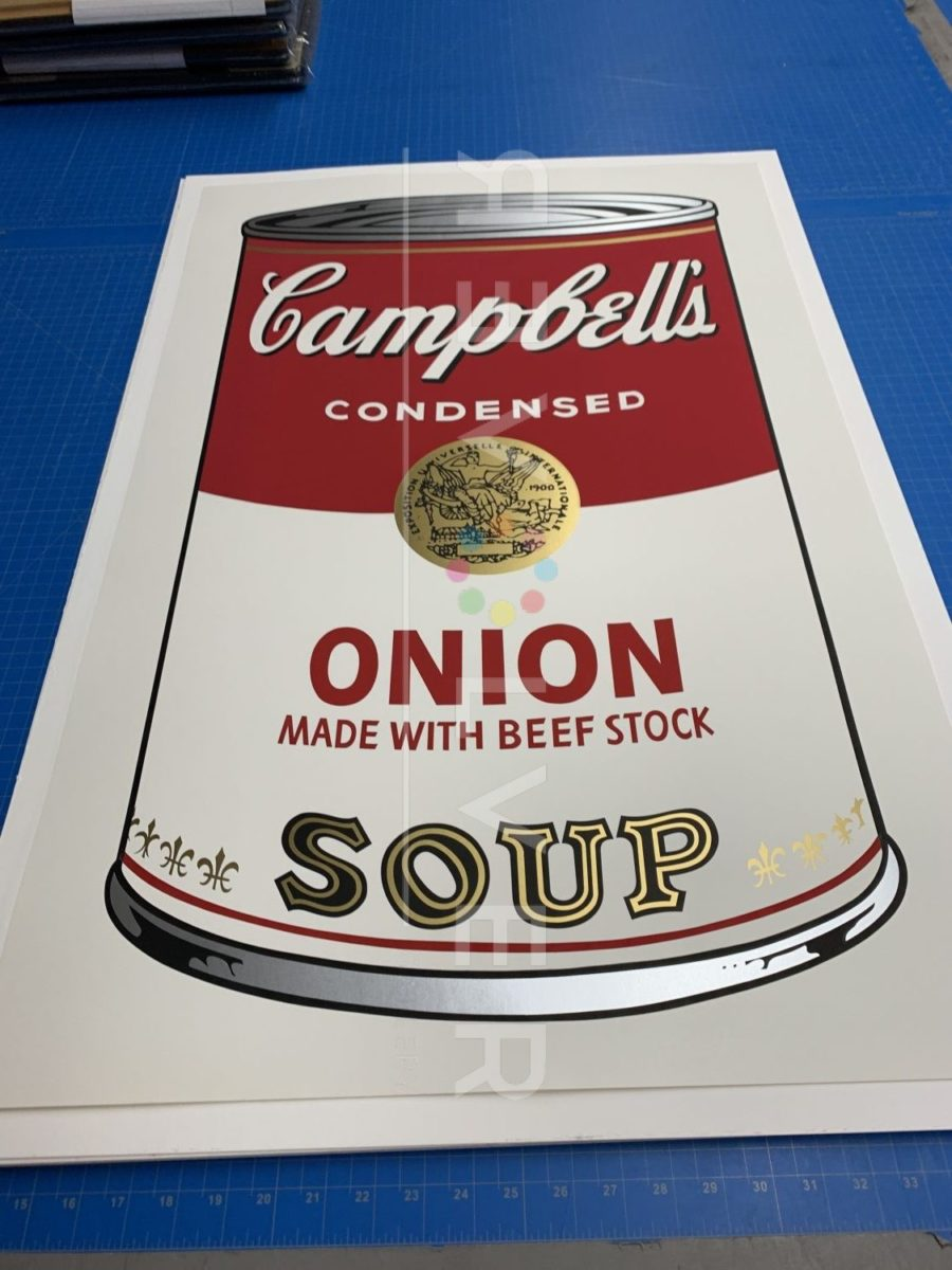 Andy Warhol Campbell's Soup I: Onion 47 screenprint laying on table.
