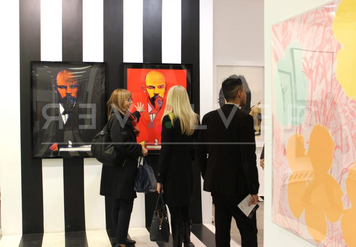 Gallery patrons admiring Red Lenin 403 by Andy Warhol.