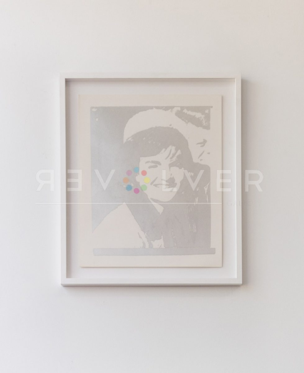 Andy Warhol Jackie Kennedy 13 screenprint framed and hanging on the wall. Basic stock image.