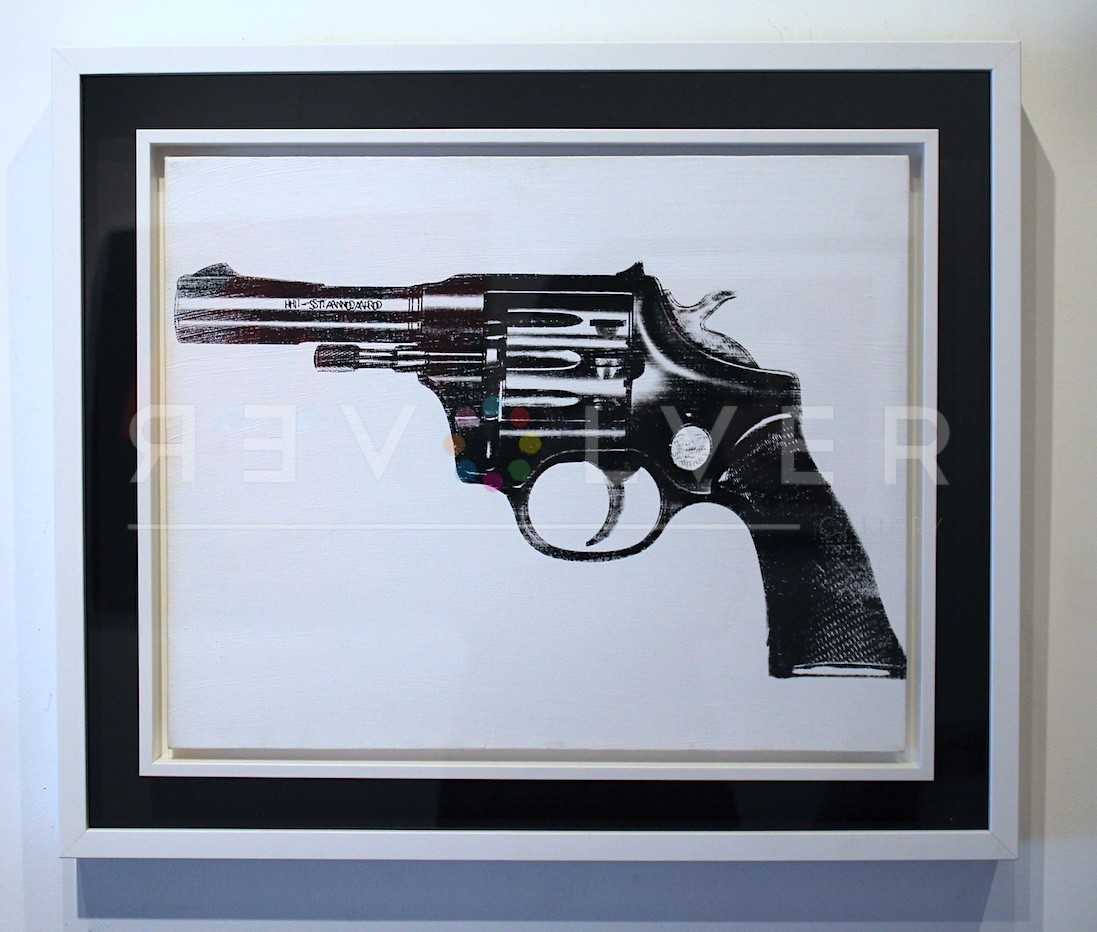 Andy Warhol Gun framed and hanging on the gallery wall.
