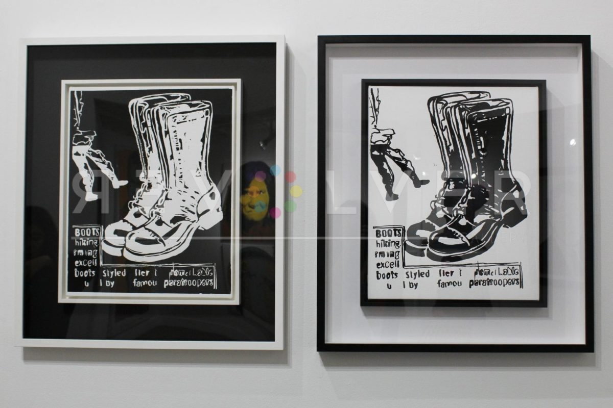 Andy Warhol Paratrooper Boots (Negative) hanging next to Paratrooper Boots (Positive) on the gallery wall, framed.