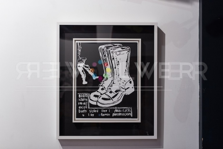 Installation view of Paratrooper Boots (Negative) by Andy Warhol framed and hanging on the gallery wall.