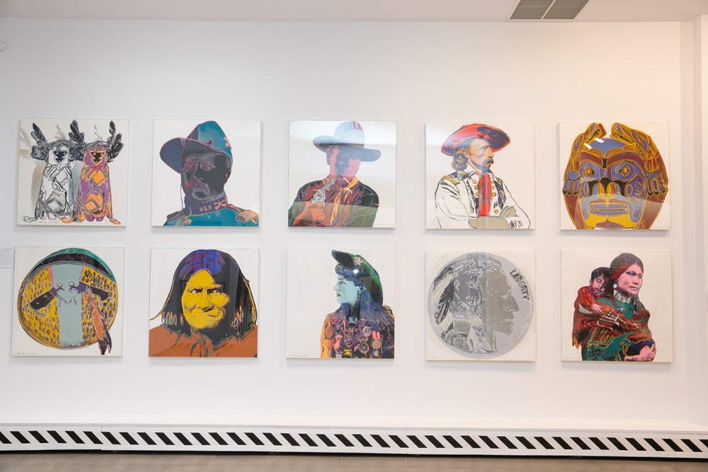 Andy Warhol Cowboys and Indians complete series hanging on the wall