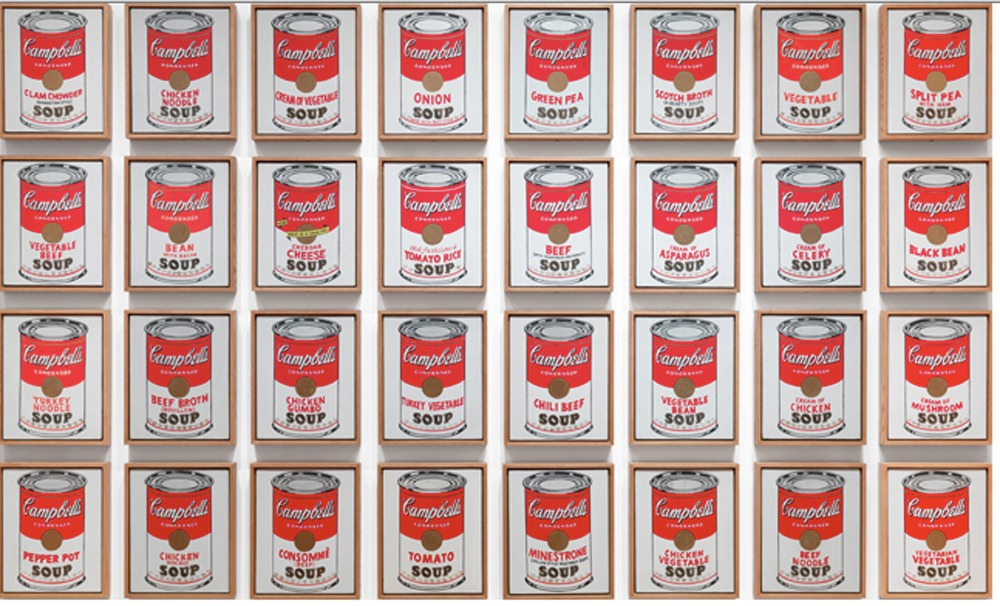 32 Soup cans framed and on the wall by Andy Warhol, including all prints from the Campbell's Soup I complete portfolio.