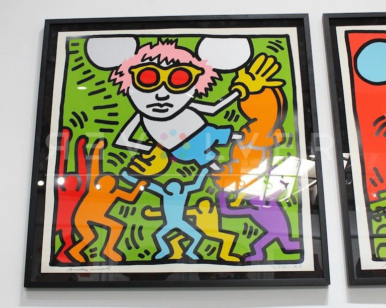 Print from the Andy Mouse series by Keith Haring, framed and hanging on the wall. Signed by Warhol and Haring.