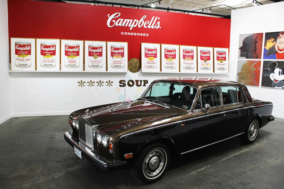 The complete Campbell's Soup II portfolio of ten screenprints hanging on the gallery wall above Warhol's Rolls Royce.