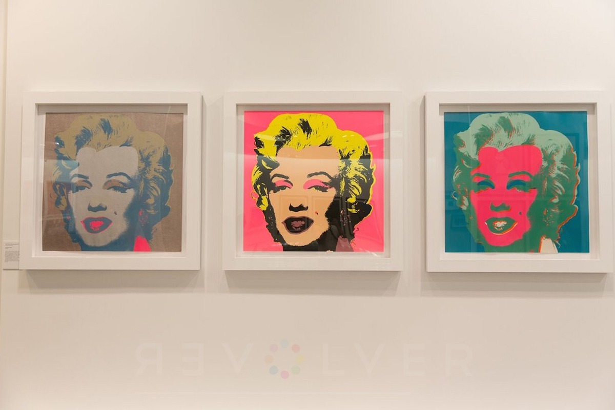3 Marilyn prints by Andy Warhol hanging on the wall in white frames.