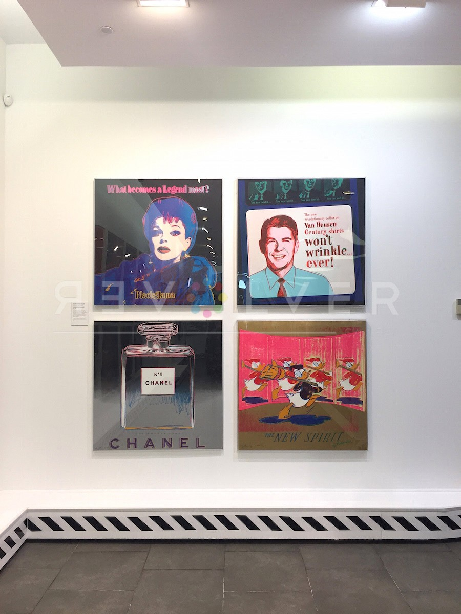 Four screenprints from Andy Warhol Ads hanging on gallery wall. Included are Blackglama 351, Van Huesen 356, Chanel 354, and The New Spirit (Donald Duck) 357.
