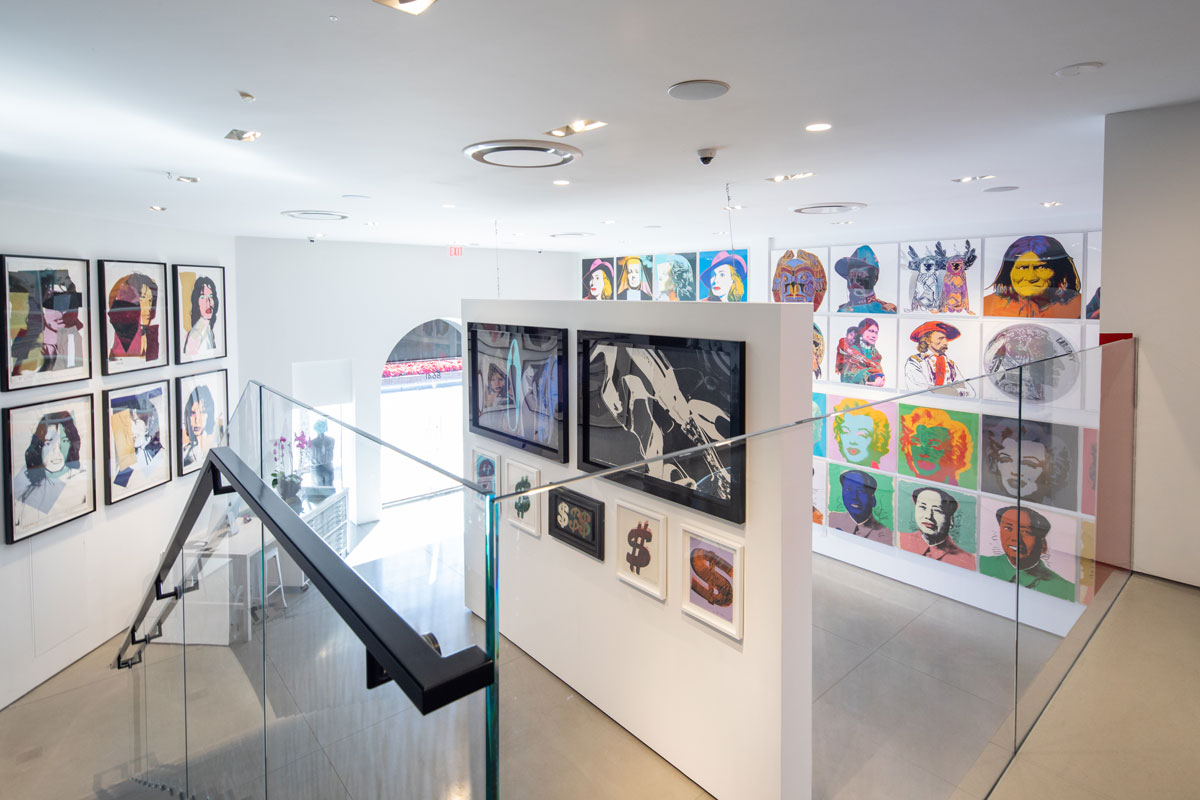 Revolver Gallery inside, upstairs, Mick Jagger, Dollar Signs, Shoes, Marilyn, Mao, and Cowboys on gallery wall.