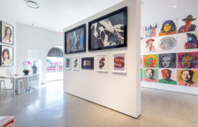 Inside Revolver Gallery on Sunset Blvd, Shoes, Mick Jagger, Dollar Signs on gallery wall.