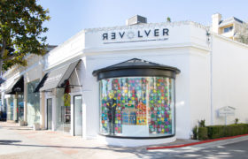 Storefront of Revolver Gallery, window display statues on Sunset Blvd.