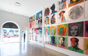 Inside of Revolver Gallery, Mao, Marilyn Monroe, Cowboys and Indians, Myths, Ads, and Ingrid Bergman screen prints on gallery wall.