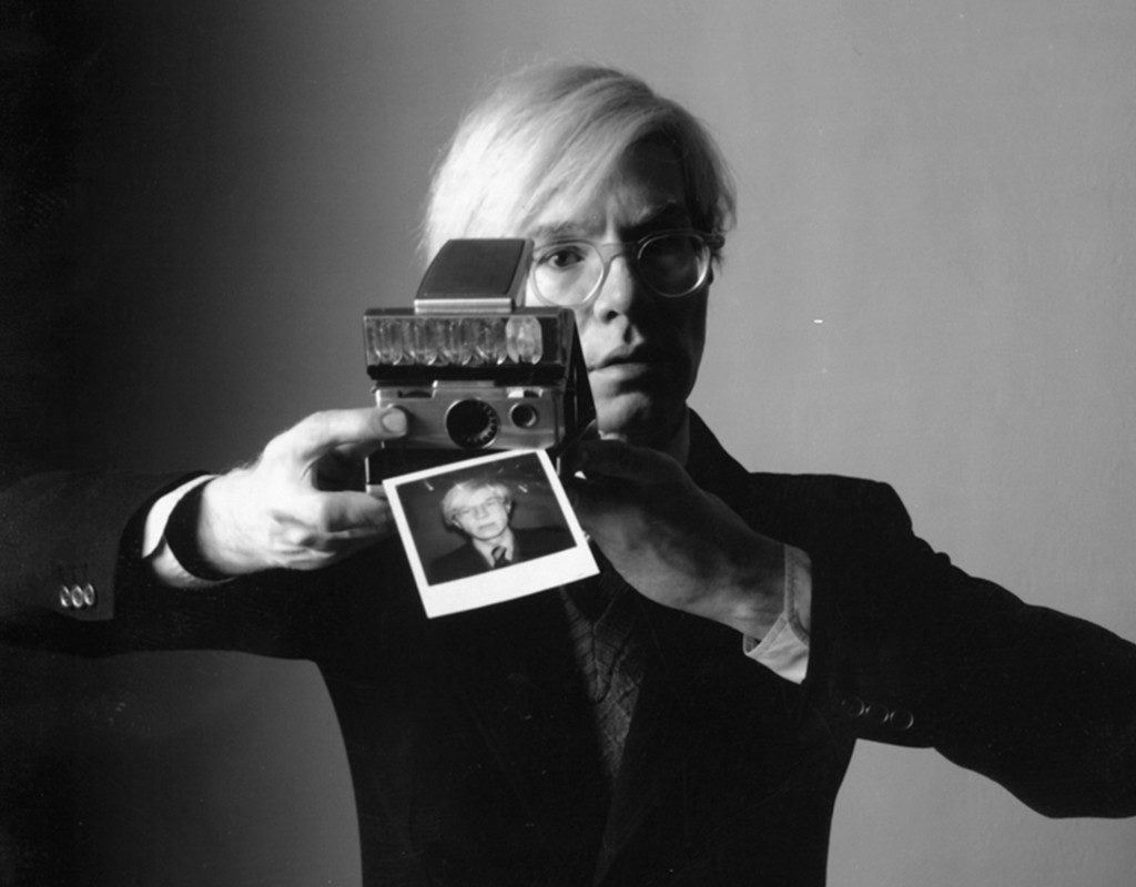 Andy-Warhol-with-a-Polaroid-Camera